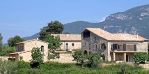 This holiday Loft is on the ground floor. at the back of a beautifully restored Catalonian farmhouse or Masia.